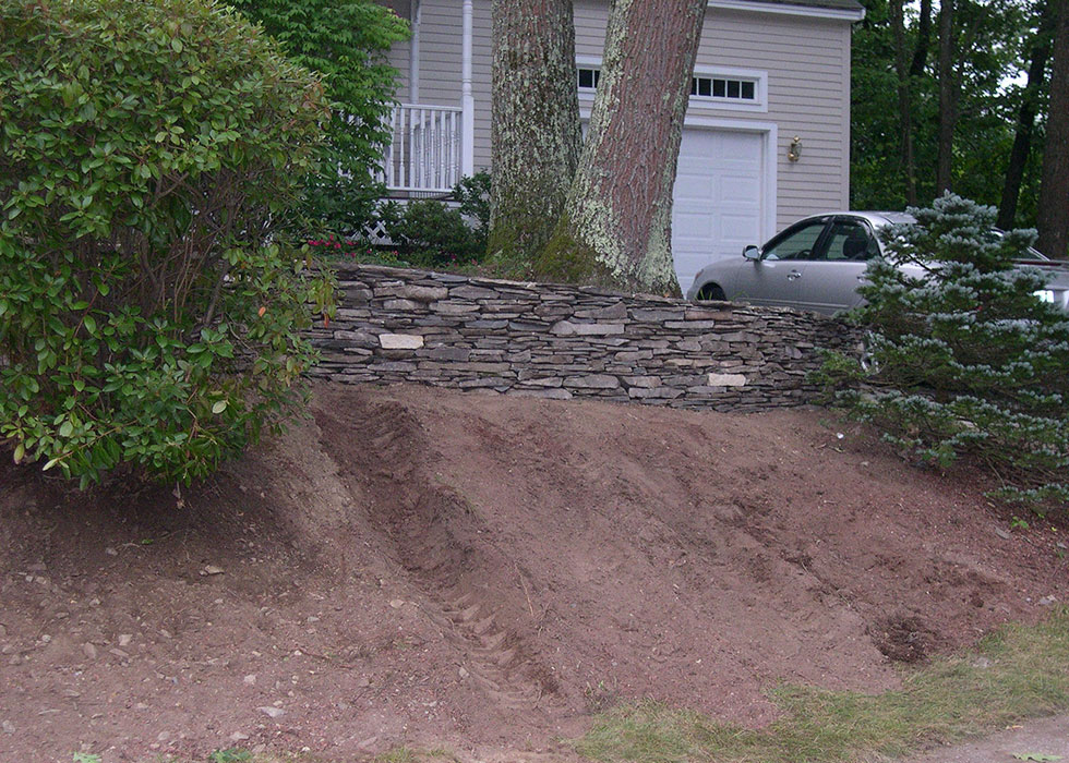 distinctive stoneworks - retaining wall